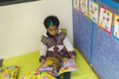 Aaral - Reading a story book