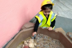 Shanaya - Breaking stones at the construction site