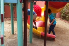 Having fun by going up from the slide